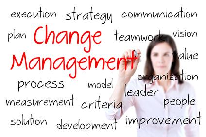 Young business woman writing change management concept. Isolated on white.